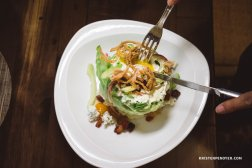 The Wedge Salad |Bacon | Tomatoes | Cucumber | Blue Cheese | Egg Crispy Onions | Green Goddess dressing| This salad features a perfectly poached egg cooked at 63°