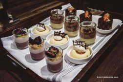 Dessert Tray - From left to right: The Ritz-Carlton Signature Chocolate Cake, Salted Caramel Mousse , Blood Orange Cheesecake, Blackberry Buttermilk Panna Cotta