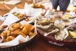 Bang bang shrimp tacos, fried shrimp basket, and oysters
